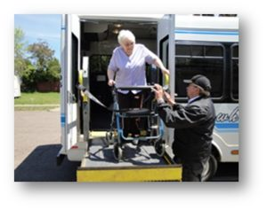 Woman with walker being assisted by the driver of a lift-assisted bus in Duluth, MN